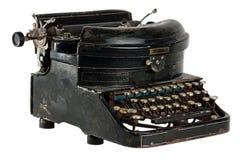 在白色查出的古色古香的打字机 免版税库存照片