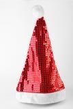 在白色查出的唯一圣诞老人红色帽子 免版税库存图片