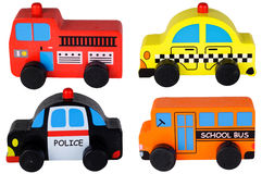 在白色查出的套四辆木玩具汽车 库存图片