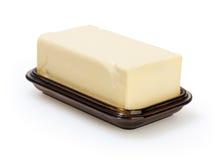在白色查出的奶油碟 免版税库存图片