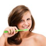 在白色查出的妇女掠过的牙 库存图片