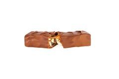 在白色查出的巧克力块特写镜头 库存照片
