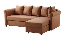 在白色查出的布朗沙发 免版税库存图片