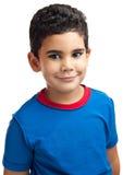 在白色查出的愉快的拉丁男孩 库存照片