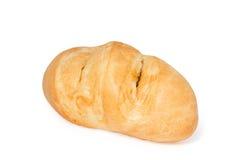 在白色查出的新近地被烘烤的麦子面包 库存照片