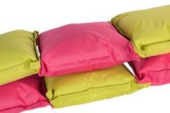 在白色查出的明亮的枕头 库存图片