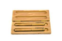 在白色查出的木箱的二支木笔 免版税图库摄影