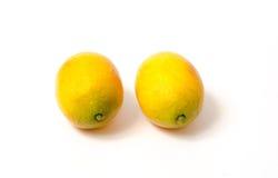 在白色查出的柠檬 库存照片