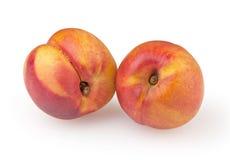 在白色查出的油桃 免版税库存图片