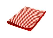 在白色查出的红色方格的野餐布料 库存照片