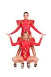 在白色查出的红色服装的性感的舞蹈演员 库存照片