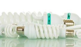 在白色查出的节能荧光灯电灯泡 库存照片