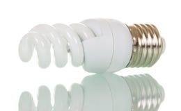 在白色查出的节能荧光灯电灯泡 免版税库存图片