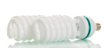在白色查出的节能荧光灯电灯泡 库存图片