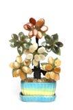 在白色查出的花盆的人造花 库存图片