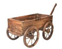 在白色查出的葡萄酒木购物车 免版税库存图片