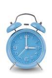 在白色查出的蓝色闹钟 库存照片