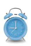 在白色查出的蓝色闹钟 免版税库存图片