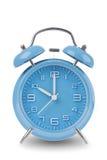 在白色查出的蓝色闹钟 免版税库存照片
