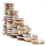 在白色查出的被堆积的货币 免版税库存照片