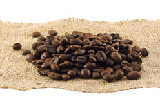 在白色查出的谷物的咖啡 库存照片