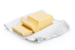 在白色查出的黄油 免版税库存照片