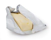 在白色查出的黄油 免版税库存图片