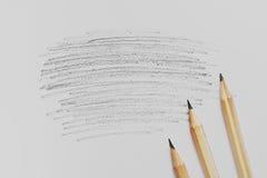 在白色桌上的三支铅笔 免版税库存照片