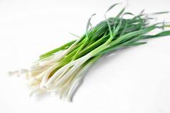 在白色桌上的新鲜的绿色大蒜 库存图片