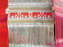 在白色棉花旗子的红色大象 库存照片