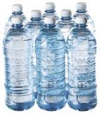 在白色水隔绝的塑料瓶 免版税库存图片