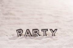 在白色沙子的党词 图库摄影