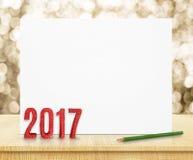 在白色海报的新年2017红色闪烁3d翻译在木头 免版税图库摄影