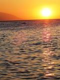 在白色海滩Puerto加莱拉角的日落 免版税库存照片