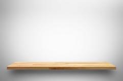 在白色灰色背景的木架子 免版税库存图片