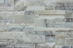 在白色灰色颜色的大理石瓦片墙壁纹理样式背景 库存图片