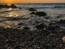 在白色点海滩,新斯科舍,加拿大的日出 库存照片
