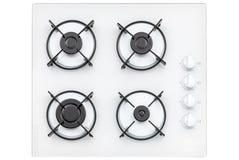 在白色玻璃煤气灶的燃烧器在厨房里 在视图之上 背景查出的白色 库存照片