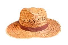 被隔绝的黄色柳条草帽。 图库摄影