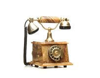 在白色的一个美丽的老葡萄酒电话 免版税图库摄影