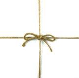 在白色的一把弓附加的字符串 免版税库存图片