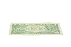 在白色的一美元美国货币 库存图片