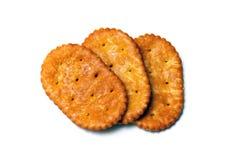 在白色的三个卵形薄脆饼干 免版税库存照片