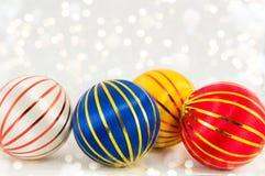 在白色的三个圣诞节球 图库摄影
