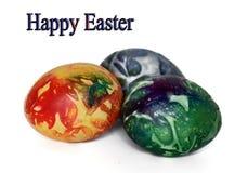 在白色的三个美丽的复活节彩蛋 免版税库存图片
