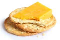 在白色的三个金黄乳酪薄脆饼干 免版税库存图片