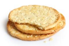 在白色的三个金黄乳酪薄脆饼干 库存图片