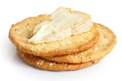 在白色的三个金黄乳酪薄脆饼干 免版税图库摄影