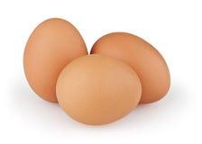 在白色的三个鸡蛋 免版税库存图片