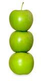 在白色的三个绿色苹果 库存图片